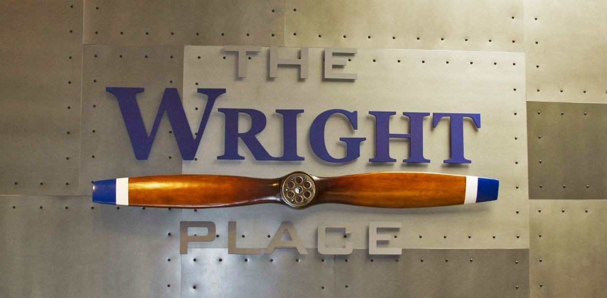 3D Sign for the Wright Place Restaurant, with text and an airplane propeller