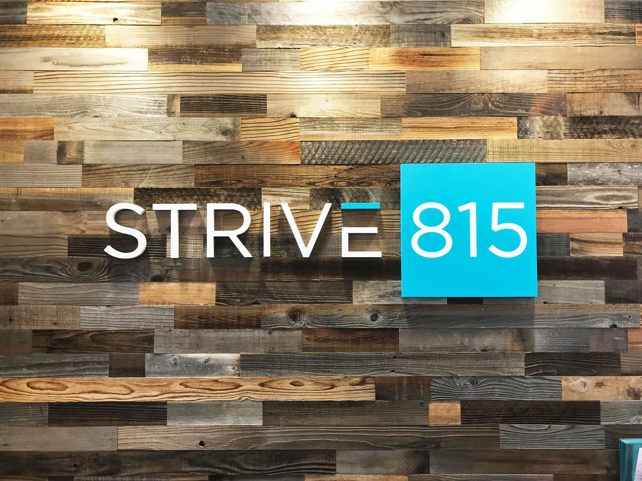 Strive 815 Dimensional Sign with 3-quarter inch thick dimensional letters installed onto a reclaimed wood wall