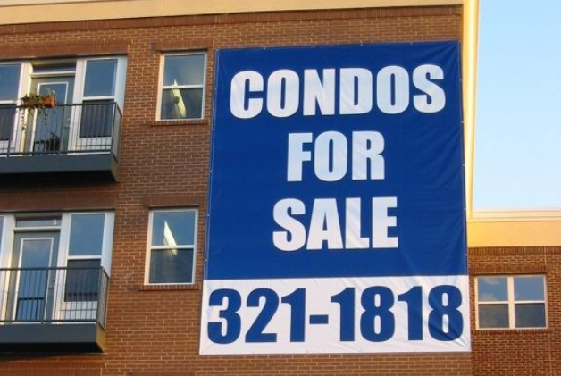Real estate outdoor vinyl banner promoting condos for sale