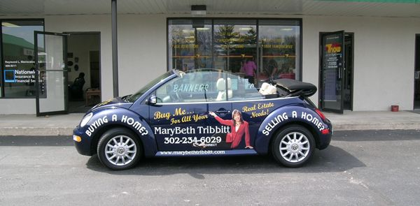 Vehicle wrapped for real estate marketing professional