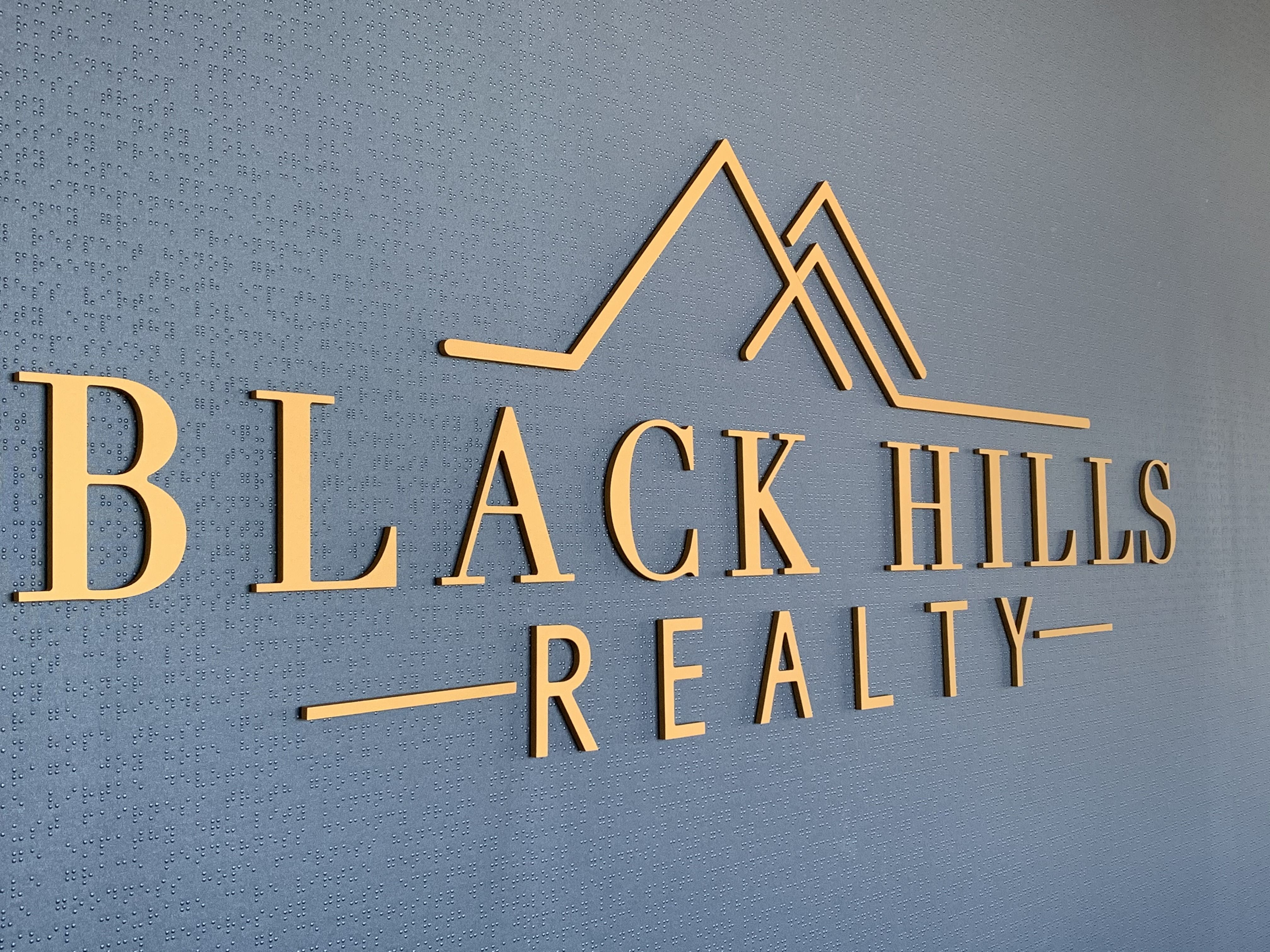 3D custom logo sign for real estate lobby